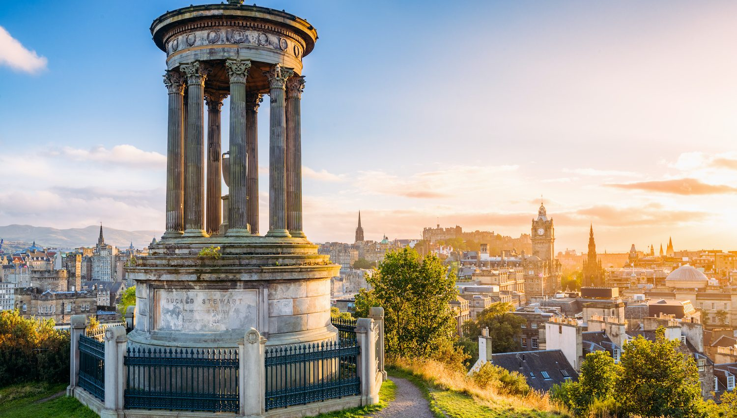 ESPLS   A view over central Edinburgh at sunset, taken from Calton Hill, with the stone memorial to  Dugald Stewart (1753 - 1828) in the foreground.